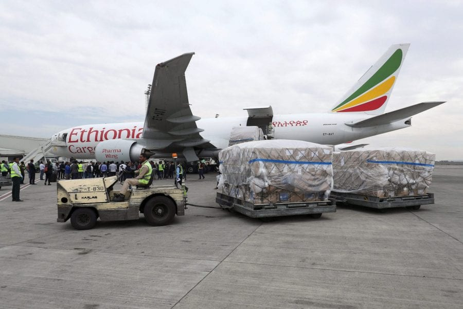 An Ethiopian Airlines worker transports a consignment of the medical donation from Chinese billionaire Jack Ma - REUTERS/Tiksa Negeri - RC2ZOF95SBCB